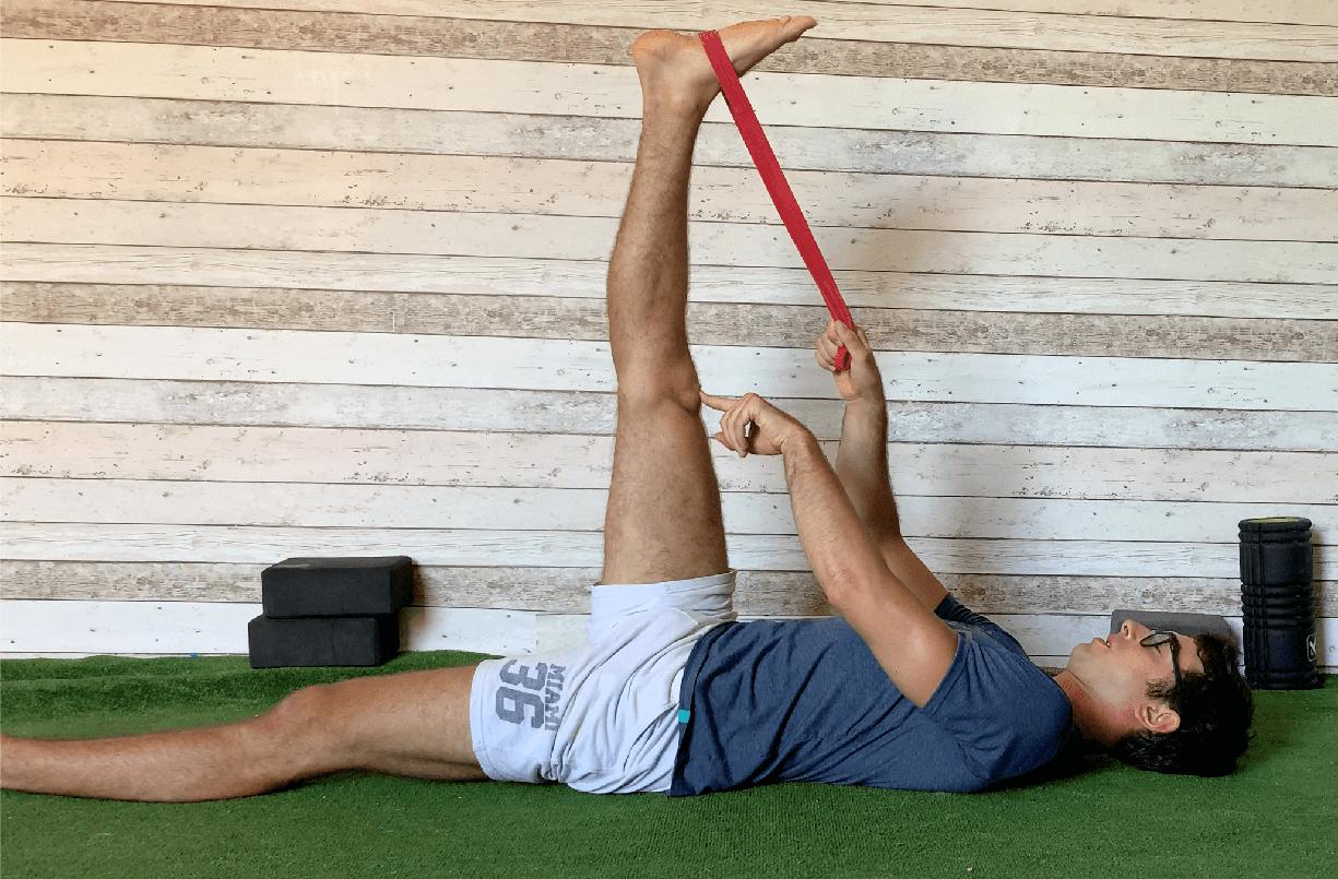 Esercizio stretching ischiocrurali